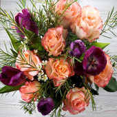 Bouquet of flowers on wooden background — Stockfoto