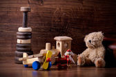 Collection of old wood children toys with teddy bear — Foto de Stock
