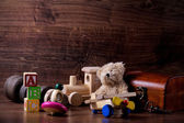 Collection of old wood children toys with teddy bear — Stock Photo