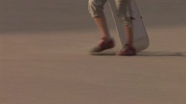 Woman sandboarding — ストックビデオ