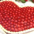 Heart-shaped strawberry cake — Stock Video #37229211