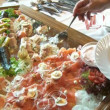 Stock Video: People taking food in buffet
