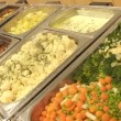 Stock Video: Potato and vegetables in buffet
