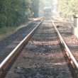 Train approaches on tracks — Wideo stockowe #38993873