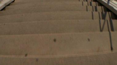 Man walking downstairs — Stockvideo