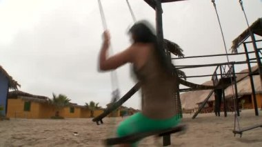 Young woman on a swing — Stock Video