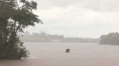 Boat on the river in rainy day, South America — Stock Video