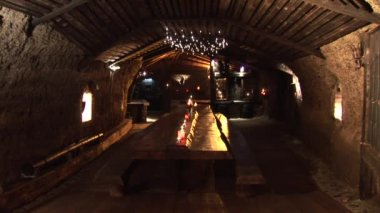 Cande light in the vaulted cellar — Stock Video