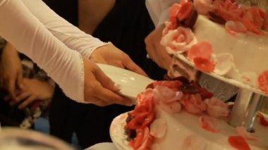 Bride taking wedding cake — Stock Video