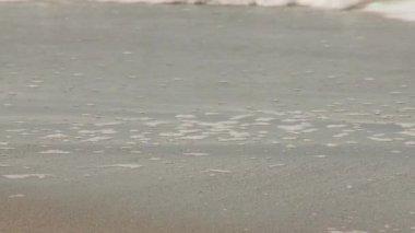 Woman walking along the beach — Stockvideo