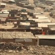 Stock Video: Slums in desert