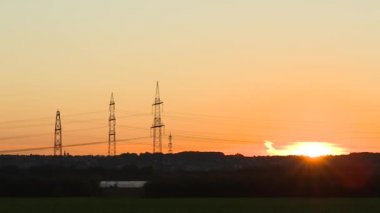 Sun setting over power lines — Stock Video