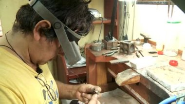 LIMA - CIRCA 2012: working goldsmith — Stock Video