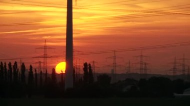 Power poles in the red sunset — Stock Video