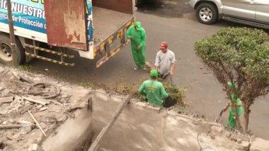 LIMA, PERU - CIRCA NOV 2012: working gardeners — Stock Video