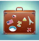 Vector Leather Suitcase with Travel Sticker — Stock Vector