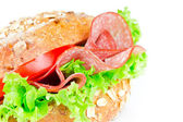 Bun with salami — Stock Photo