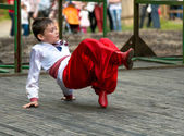 Boy dancing the national dance — Stock Photo
