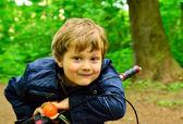 Boy on a bike — Stock Photo