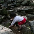 Baby Korean playing in a creek. — Stock Video #40121377