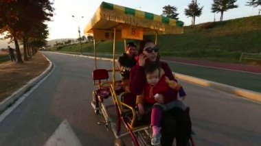 Family in a Pedal Bus — Vídeo de stock