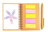 Nota carta e notebook con graffetta — Foto Stock