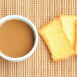 Breakfast with coffee and sugar bread on bamboo background — Stock Photo