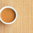 Coffee cup on the table with woven bamboo — Stock Photo #31212463