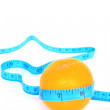Orange wrapped with measuring tape — Stock Photo