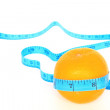 Orange wrapped with measuring tape — Stock Photo #31212585