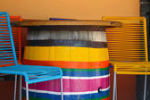 Colorful chairs and barrel table on mexican plaza — Stock Photo