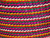 Woven traditional colorful mexican basket close up — Stock fotografie