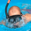 Man swims with diving goggles — Stock Photo