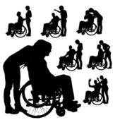 Vector silhouettes of people in a wheelchair. — Stockvektor