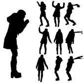 Vector silhouette of woman in winter clothes. — Stockvector