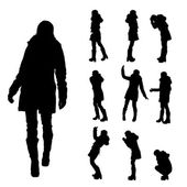 Vector silhouette of woman in winter clothes. — Stockvektor