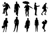 Vector silhouettes of business people. — Cтоковый вектор