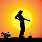 Vector silhouette of a gardener. — Stock Vector
