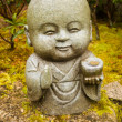 Little Buddha statue in the garden — Stock Photo #30589183