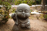 Little Buddha statue in the garden — Stock Photo