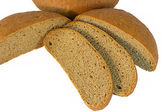 Loaf of bread with sliced piaces — Stock Photo