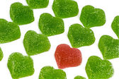 Red heart in green hearts — Stock Photo