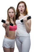 Two girls do fitness — Stock Photo