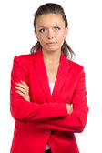 Portrait of businesswoman in red suit — Stock Photo