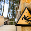 Slippery when wet - Wooden Sign in Park — Stock Photo #30818891