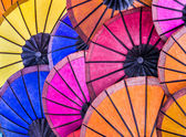 Multicolored Umbrellas at Night Market - South East Asia — Stock Photo