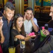 Barman performing magic Trick to surprised Guests — Stock Photo