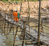 Monks on a wooden Bridge - Luang Prabang, Laos — Stock Photo