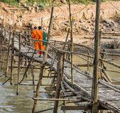 Monks on a wooden Bridge - Luang Prabang, Laos — Stock Photo
