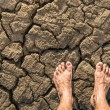 Stock Photo: Naked Feet on dry Soil